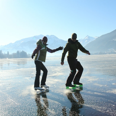 skating_at_the_frozen_lake_zell_with_the_kitzsteinhorn_in_the_background__zell_and_schmitten_to_the_right